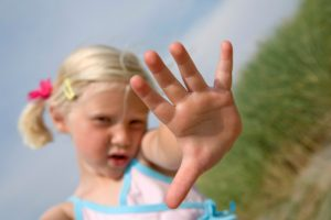 little blond girl with focus on her fingers